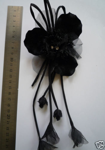 black flower brooch/corsage